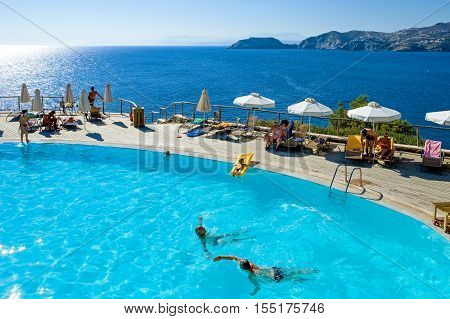 Crete Greece - June 17 2006: Tourists in an hotel pool in Agia Pelagia bay