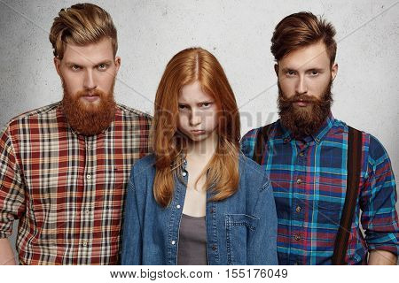 People, Relationships And Love Triangle Concept. Upset And Unhappy Redhead Girl With Frustrated Expr