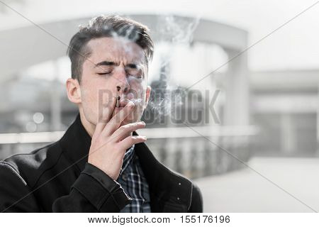 Handsome Young Man Smoking In The Street