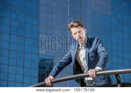 Successful Business Man Over Office Background In The Street