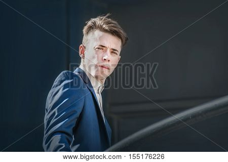 Challenge business man portrait over dark background