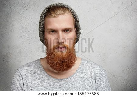 People, Style And Fashion Concept. Isolated Portrait Of Young Handsome Hipster Model With Stylish Be