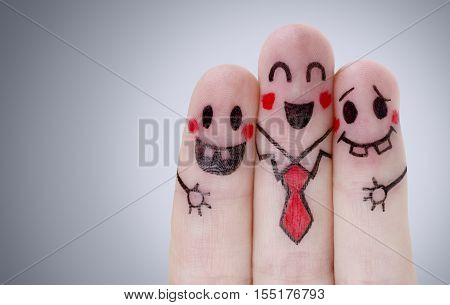 Fingers with happy smiley face on gray background