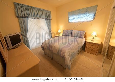 A Bedroom with a Queen Bed Interior Shot of a Home