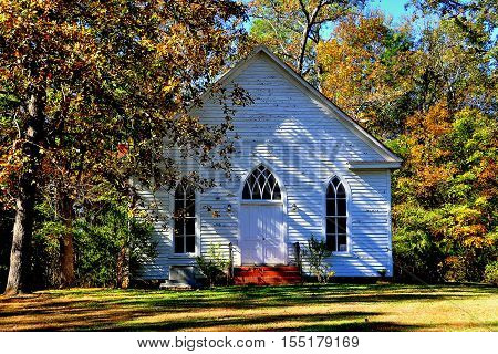 Farriington North Carolina - November 5 2016: Circa 1900 O'Kelly Chapel Christian Church white clapboard gothic revival one room rural chapel with lancet windows