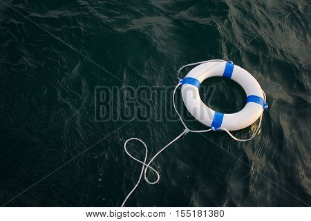 Lifebelt lifebuoy in a dangerous dark sea for help safetysecurity