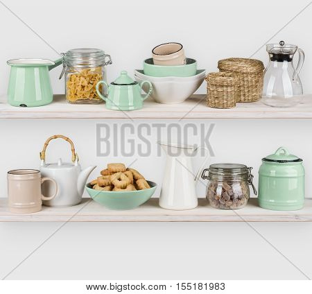Kitchen shelves interior with utensils and food ingredients on white
