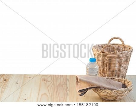 Wicker Basket, Bottle And Fabric And Fabric On Wooden Terrace Pine.  Isolated On White Background.
