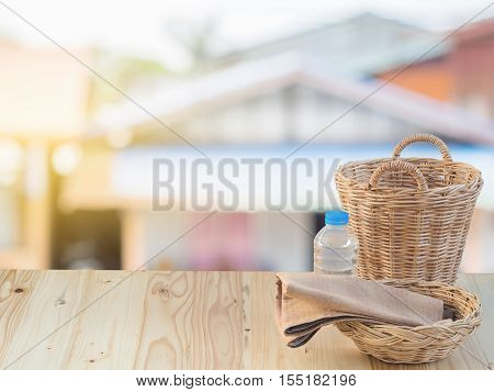 Wicker Basket, Bottle And Fabric On Wooden Terrace Pine.