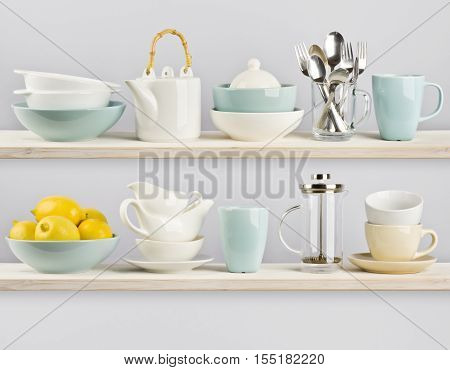 Various kitchenware arranged on two wooden shelves