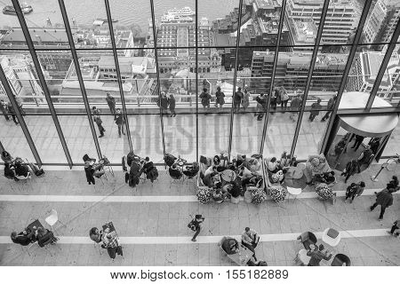 LONDON, UK - APRIL 22, 2015: People in the restaurant of the Sky Garden Walkie-Talkie building. Viewing platform is heist UK garden, locates at the 32 floor and offers amazing skyline of London city.