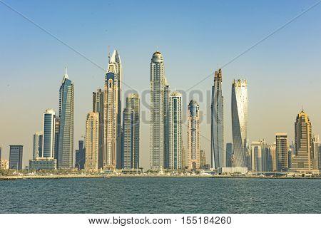 DUBAI, UAE - OCTOBER 11, 2016: The Dubai Marina skyline from the Palm Jumeirah Island on the Crescent.  The Palm Jumeirah is an artificial archipelago created using reclaimed land