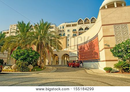 DUBAI, UAE - OCTOBER 11, 2016: A hotel front on the Palm Jumeirah Island on the Crescent.  The Palm Jumeirah is an artificial archipelago created using reclaimed land