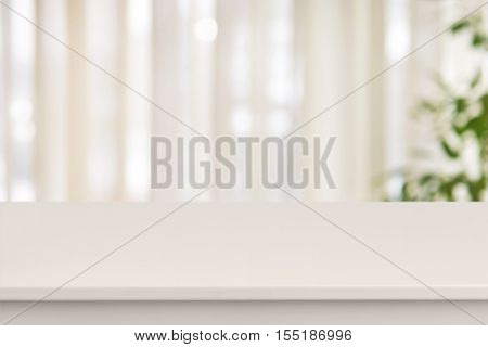Pink table on defocuced window with curtain background