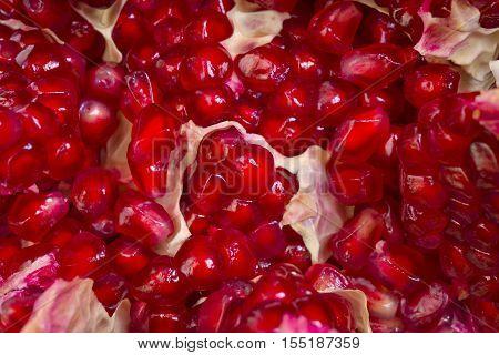 Pomegranate seeds close-up, rape fruit macro background