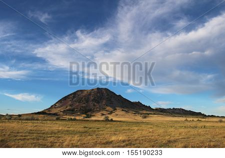 Bear Butte stands tall overlooking the South Dakota prairie.