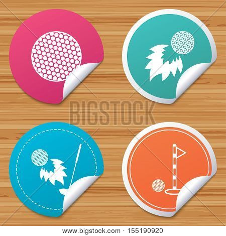 Round stickers or website banners. Golf ball icons. Fireball with club sign. Luxury sport symbol. Circle badges with bended corner. Vector