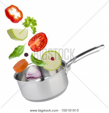 Stew pot with tossed up vegetables isolated on white