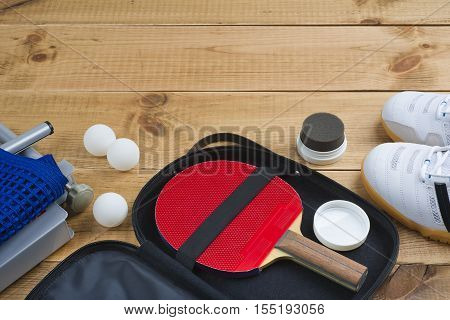 Table tennis paddle in open case with other mandatory equipment