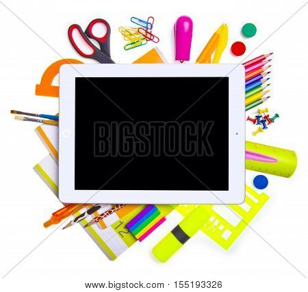 Tablet computer with school and office supplies. Online education concept. iPAD