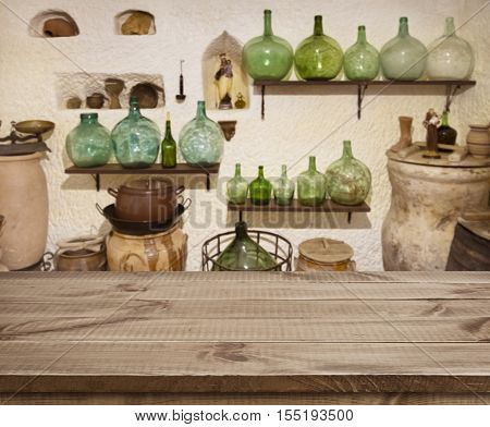 Textured wooden planks table over ancient cave kitchen interior background