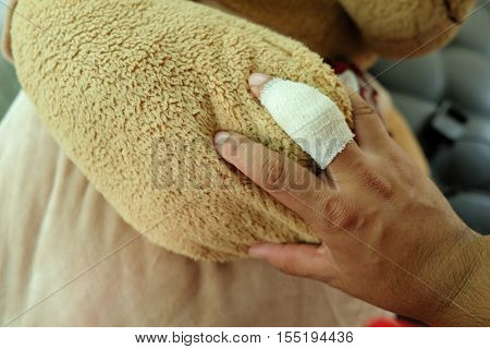 Man Finger injury with bandage. keep bear