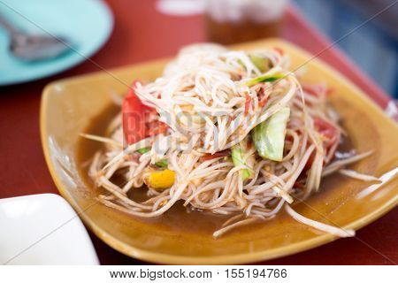 Tum Sua Papaya Salad with Vermicelli Salted Crab and Fermented Fish Traditional Thai Food selective focus