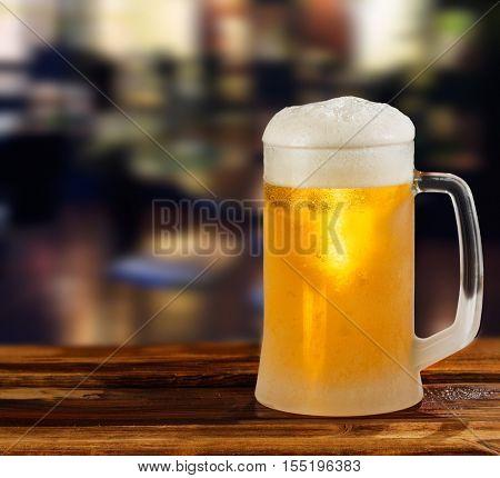 cold light beer glass mug in a pub