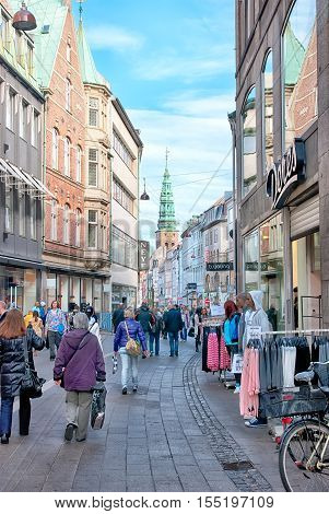 COPENHAGEN, DENMARK - APRIL 13, 2010: People on pedestrian zone Stroget. It is a longest shopping street in Europe. Located in the center of old part of the capital.