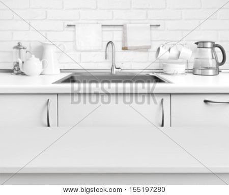 White laminated table on blurred rustic kitchen sink interior background