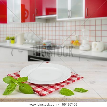White plate on table placemat over modern kitchen interior background