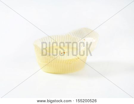 empty paper cupcakes cases on white background