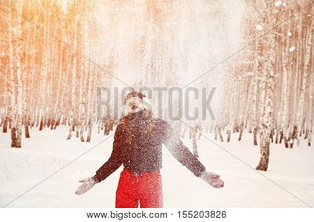 woman on the winter walk in the park. people outdoors. falling snow