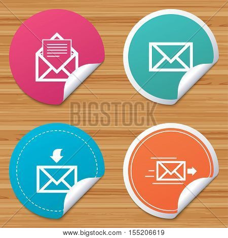 Round stickers or website banners. Mail envelope icons. Message document delivery symbol. Post office letter signs. Inbox and outbox message icons. Circle badges with bended corner. Vector