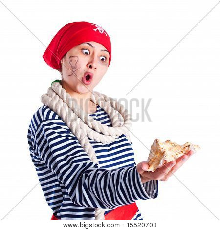 Girl Dressed As A Pirate With A Seashell