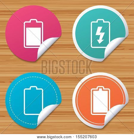 Round stickers or website banners. Battery charging icons. Electricity signs symbols. Charge levels: full, empty. Circle badges with bended corner. Vector
