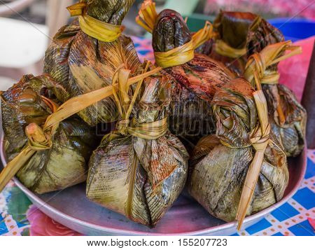 Meat And Rise Wraped In Palm Leaves