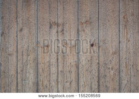 Background made of vertical wooden brown laths.