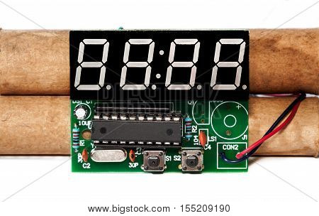 Explosives with electronic clockwork on a white background