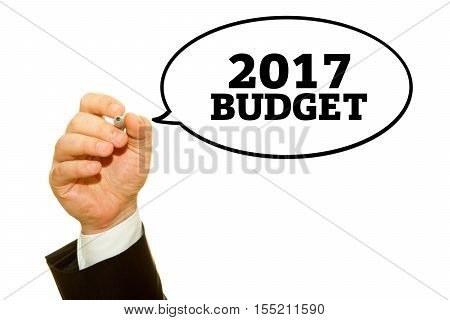 Hand writing Budget 2017 with a marker on a transparent wipe board.