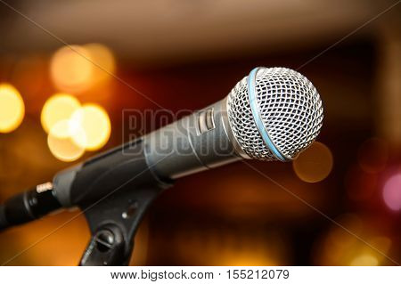 Dynamic microphone for singing. Accessory indispensable singers. Symbol of musical performers. Scenario attribute to performances of artists. Tool for voice karaoke.
