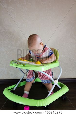 Baby sitting in baby walkers. The child learns to walk