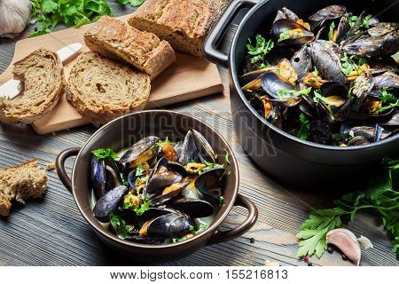 Fresh mussels prepared at home on old wooden table