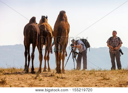Photographers Take Pictures At The Pushkar Fair, India