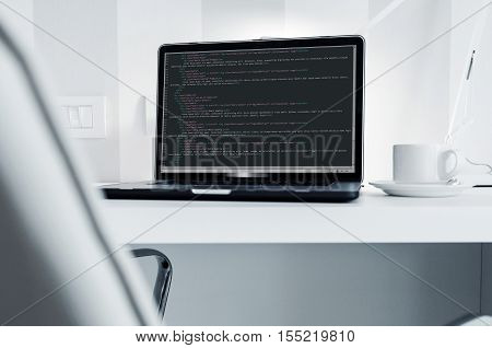 Programmer Work Station. White Clean Modern Office with Laptop Computer and Some Webdesign Programming HTML Codes. Webdesign Project Desk