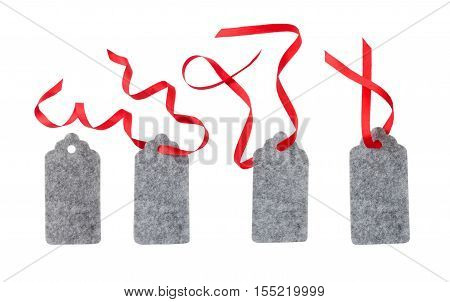 Set of color gift tags isolated on white background. Christmas gift tag tied with red ribbon. Label from gray felt.