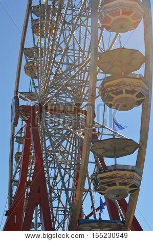vertical Ferris wheel underside passenger car sky blue