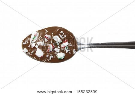 peppermint chocolate spoon. Christmas dessert. hot milk chocolate spoon with peppermint candy bits. isolated on a white background. top view, flat lay.