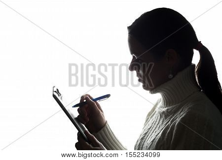 Young Woman Thoughtfully Writes, Draws, Writes