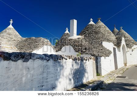 Traditional trulli houses in Alberobello Italy on summer day